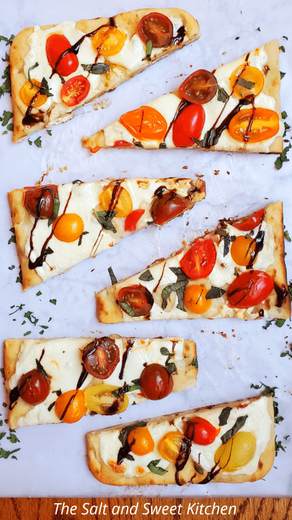 You will seriously fall in love with the quick and easy vegetarian appetizer or side dish. This Mozzarella Tomato Basil Flatbread recipe takes less than 15 minutes to throw together. It has the perfect combination of fresh flavors from fresh basil, and cherry tomatoes, to lots of mozzarella, and a crispy flatbread which is then topped with a sweet Balsamic glaze.
