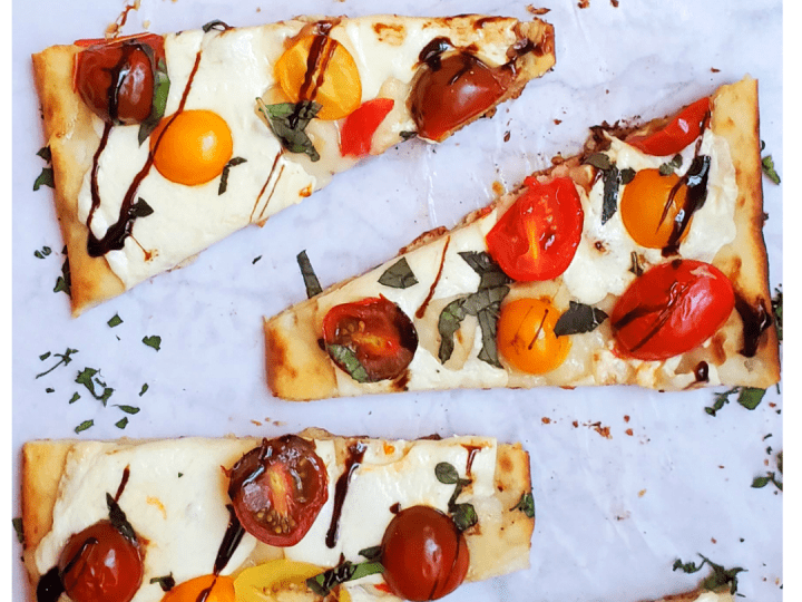 You will seriously fall in love with the quick and easy vegetarian appetizer or side dish. This Mozzarella Tomato Basil Flatbread recipe takes less than 15 minutes to throw together. It has the perfect combination of fresh flavors from the fresh basil, cherry tomato, lots of mozzarella, a crispy flatread and then topped off with a sweet Balsamic glaze.
