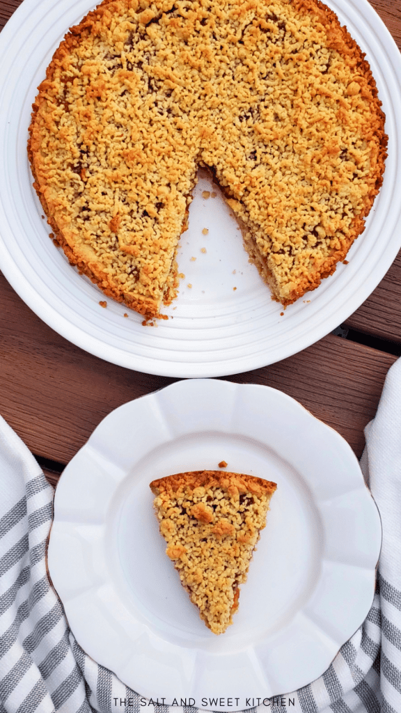 This simple Apricot Jam Tart is made with a shortcrust pastry and jam. It includes a homemade short pastry as the base, a layer of jam spread on top, and finished with crunchy crumbles of more pastry spread on top.