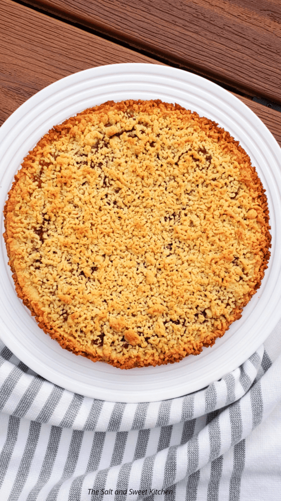 Apricot Jam Tart is made with a shortcrust pastry and jam. It includes a homemade shortcrust pastry as the base, a layer of jam spread on top, and finished with crunchy crumbles of more pastry spread on top. #jamrecipes