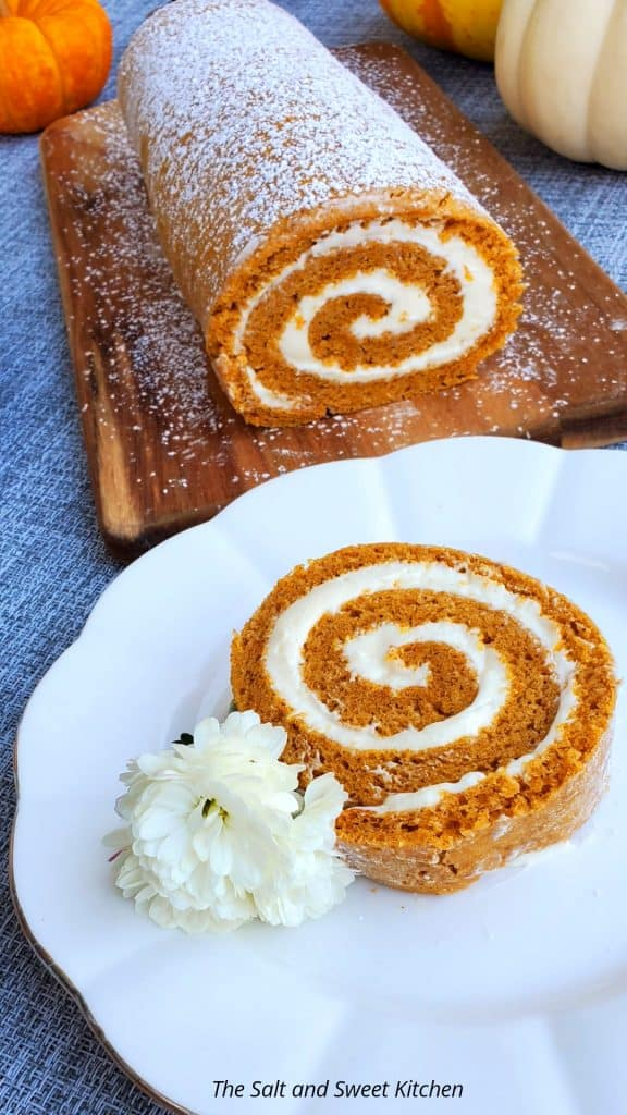if you are looking for pumpkin recipes dessert ideas, you will love this pumpkin roll with cream cheese frosting #fall desserts #falldessetrecipes #falldessertrecipeeasy