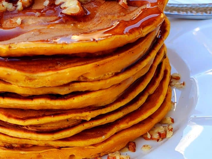 These homemade Pumpkin pancakes are quick to whip up, light and fluffy and have a lovely fall flavor. #pumpkinpureerecipess