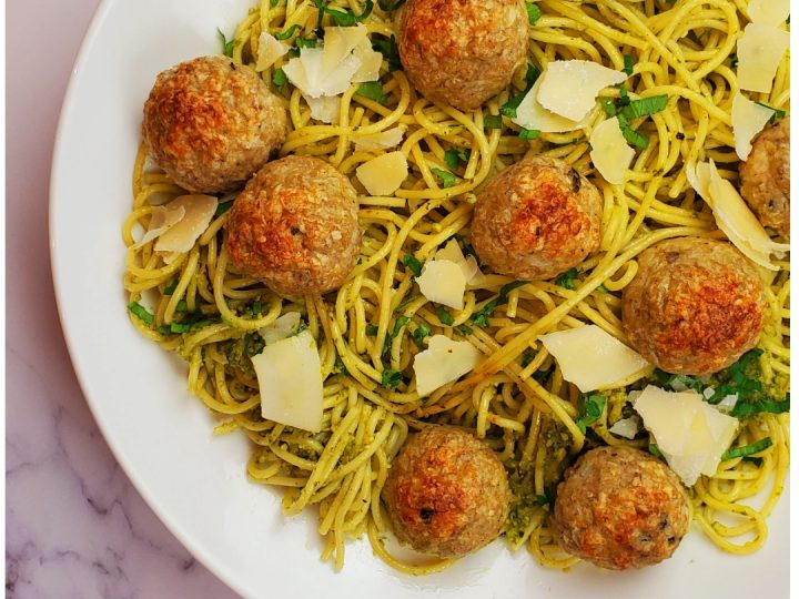 basil chicken meatballs with homemade pesto spaghetti sauce.