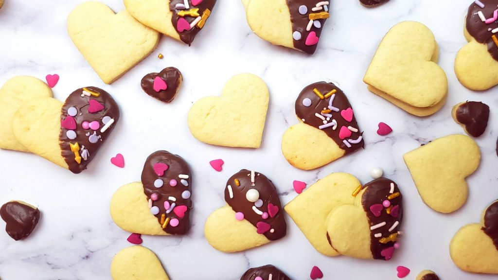 If you are looking for valentines cookies, you will love these heart cookies dipped in chocolate. This is a perfect valentines cookies for kids too!