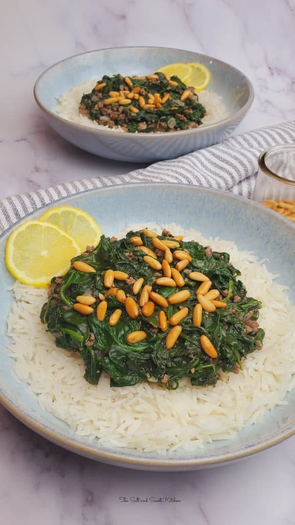If you are looking for a quick spinach stew recipe, then you will love this Lebanese Spinach Stew (Sabanekh w riz) served with pine nuts and lemon slices.