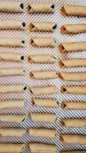 date rolls recipe- date filled dates placed on a baking sheet.
