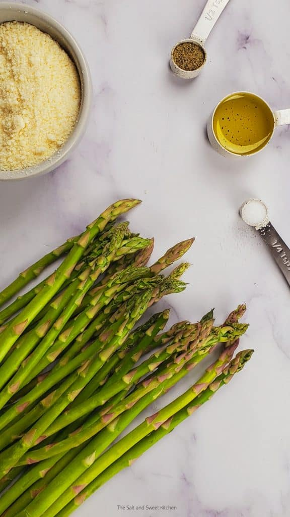 ingredients to make crispy and healthy air fryer asparagus by the salt and sweet kitchen.