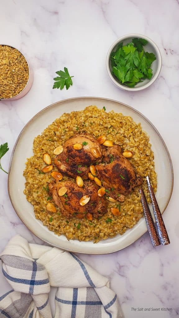 freekeh with chicken topped with roasted almonds.