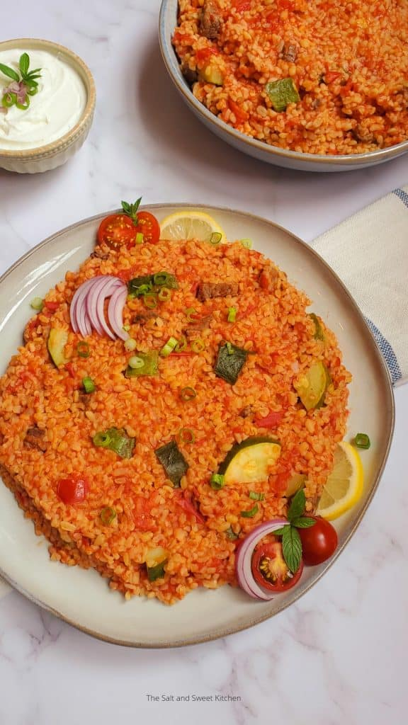 This Bulgur Pilaf with Zucchini is quick healthy meal idea! Bulgur Pilaf is a simple Lebanese dish made with beef, onion and bulgur braised in a rich tomato sauce. Some people leave out the zucchini, but I like the different texture that zucchini adds to this dish.